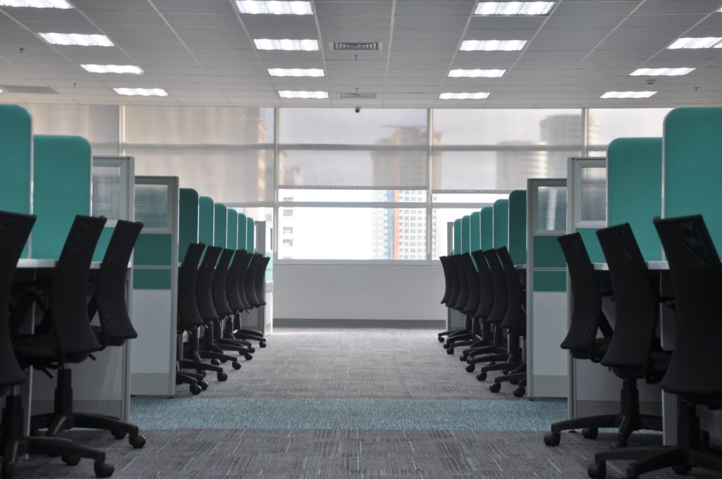 empty black rolling chairs at cubicles smart node