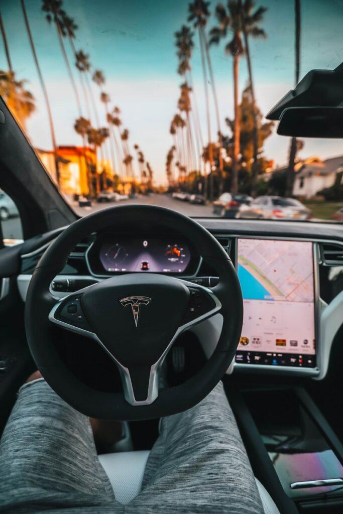 interior view of Tesla car, autonomous driving