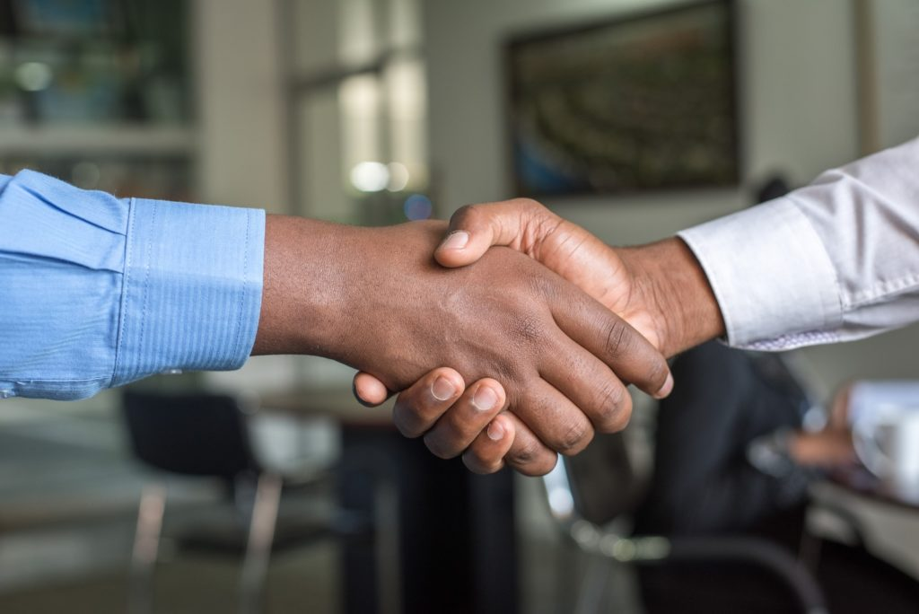 two people shaking hands like a service level agreement