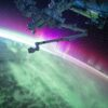 photography of purple and green aurora beam below grey space satellite Telecom Collaborations