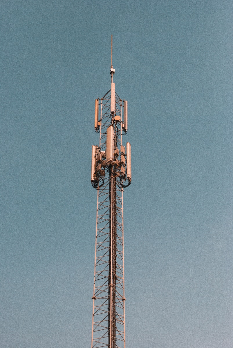 brown and white tower under blue sky during daytime 5G internet