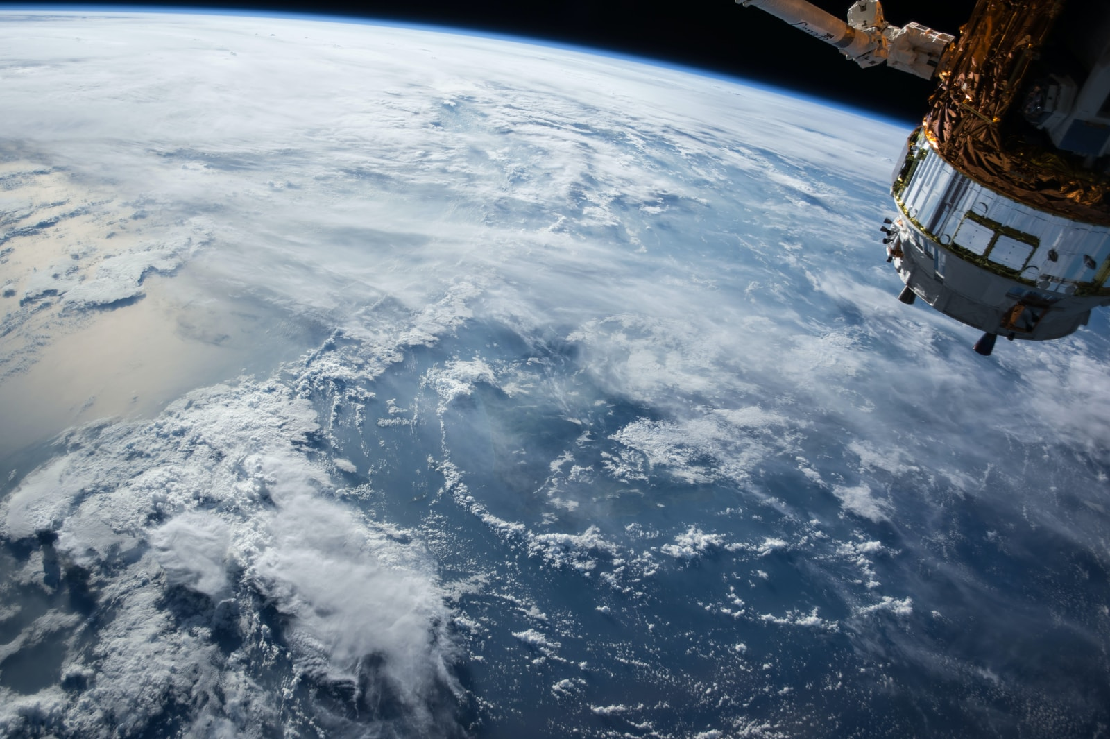 view of Earth and satellite spacex starlink