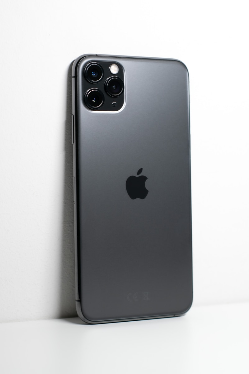 black iphone 7 plus on white surface phone porting image